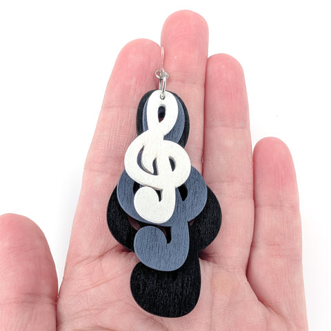 Exaggerated Treble Clef Earrings (Dangles) - size comparison hand