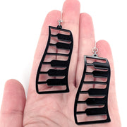 Exaggerated Piano Earrings (Dangles) - size comparison hand