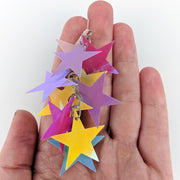 Holographic Stars Earrings (Dangles) - size comparison hand