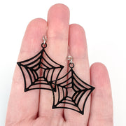 Spider Web Earrings (Dangles) - size comparison hand