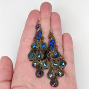 Jeweled Peacock Earrings (Dangles) - size comparison hand