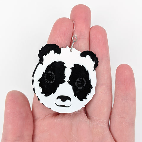 Exaggerated Panda Earrings (Dangles) - size comparison hand