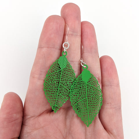 Jagged Leaf Earrings (Dangles) - small green - size comparison hand