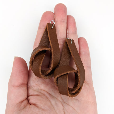 Faux Leather Knot Earrings (Dangles) - size comparison hand