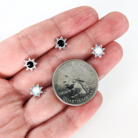 Monochrome Sun Earrings (Studs) - size comparison quarter & hand