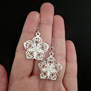 Silver Decorative Flower Earrings (Dangles) - size comparison hand