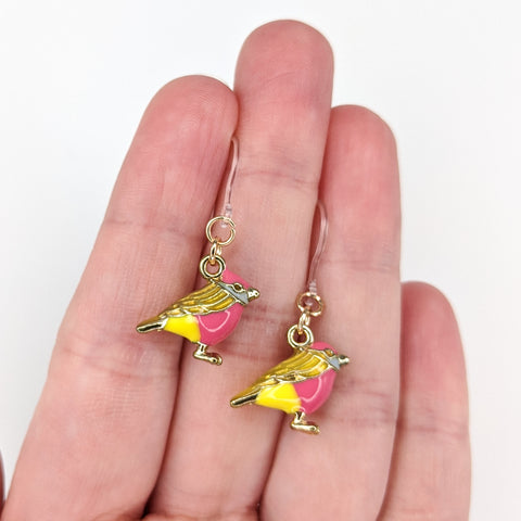 Colorful Bird Earrings (Dangles) - size comparison hand