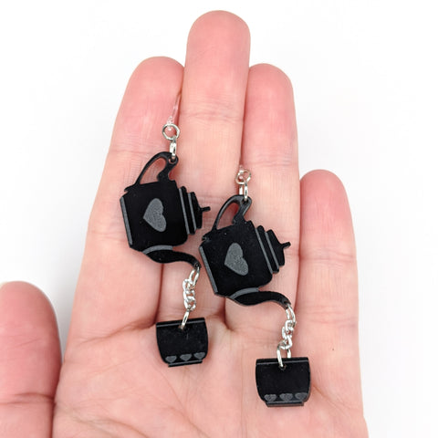 Exaggerated Tea Earrings (Dangles) - size comparison hand