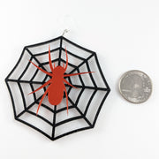 Exaggerated Spider Web Earrings (Dangles) - size comparison quarter