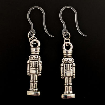 Silver Nutcracker Earrings (Dangles) - nutcracker on stand