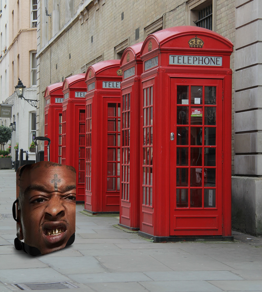 21 Savage in the UK next to a phone booth