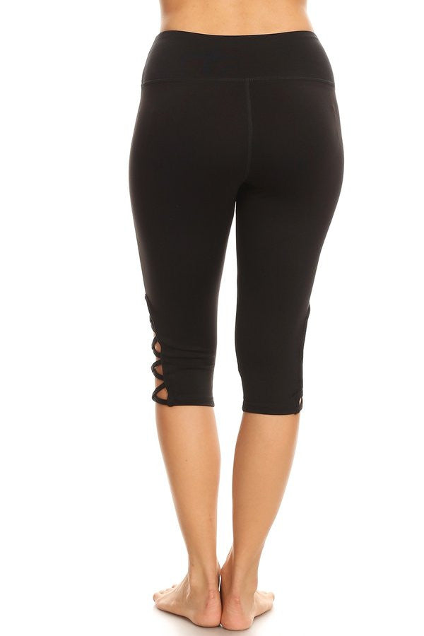 Yoga Black hi-rise Capri with a side crisscross strap cutout