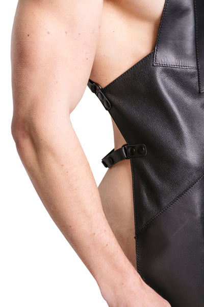Model wearing black leather cross back apron