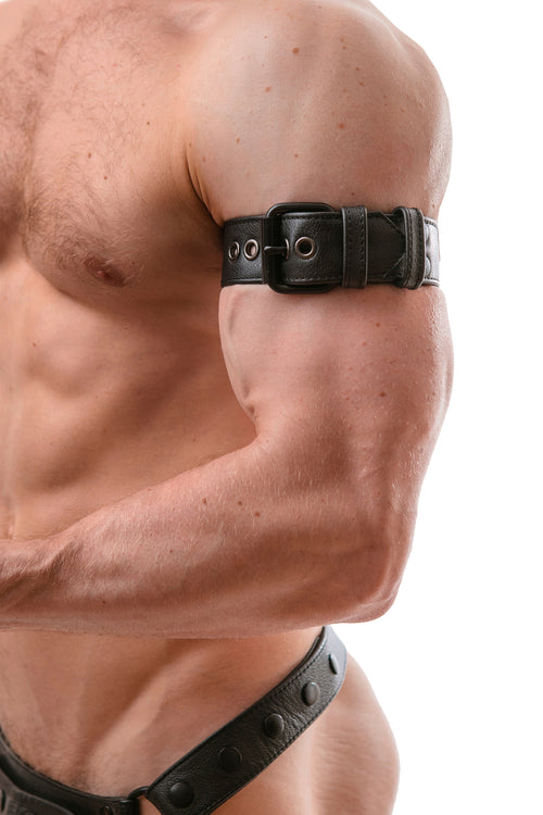 Model wearing a black leather armband belt with matt black buckle