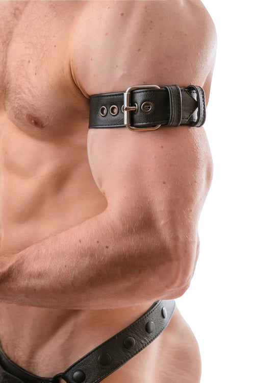 Model wearing a black leather armband belt with stainless steel buckle