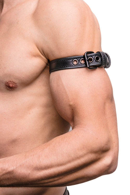 "Model wearing a 1"" black leather combat armband belt with matt black hardware"