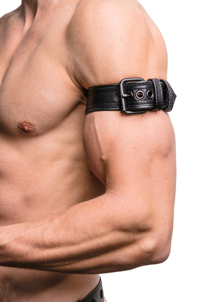 "Model wearing a 1.5"" black leather combat armband belt with matt black hardware"