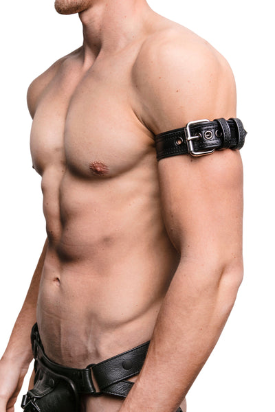 "Model wearing a 1.5"" black leather combat armband belt with stainless steel hardware"