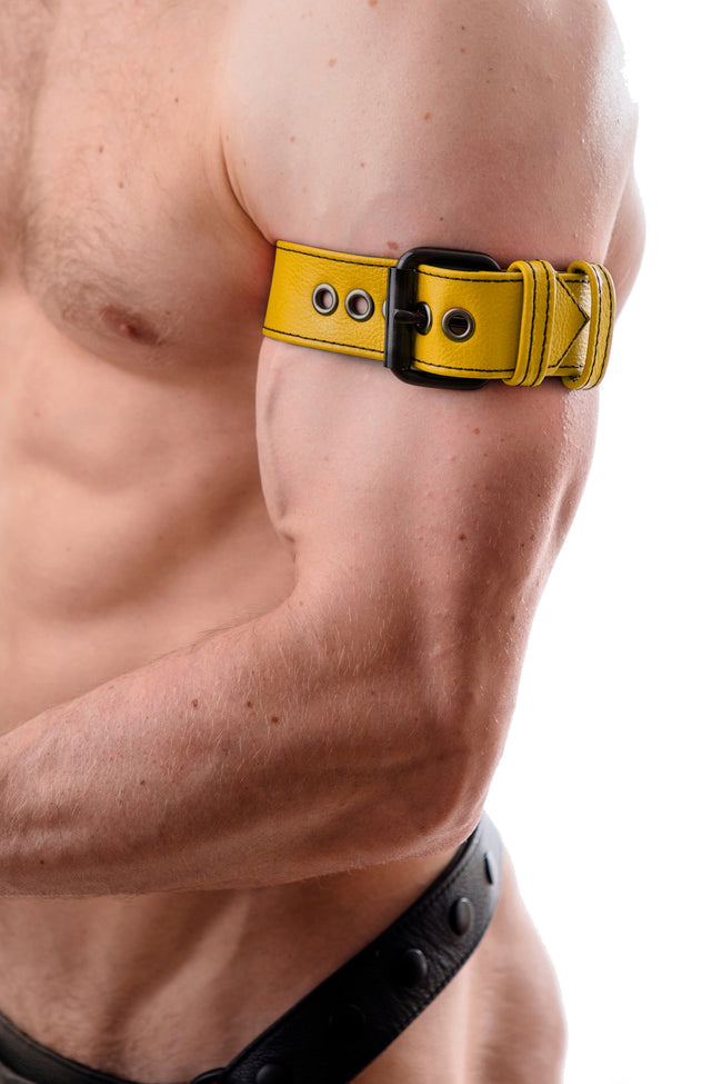 Model wearing a yellow leather armband belt