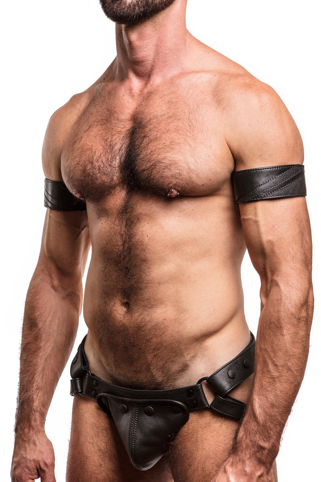 "Model wearing a 2"" black leather armband with matt black chevron detailing"