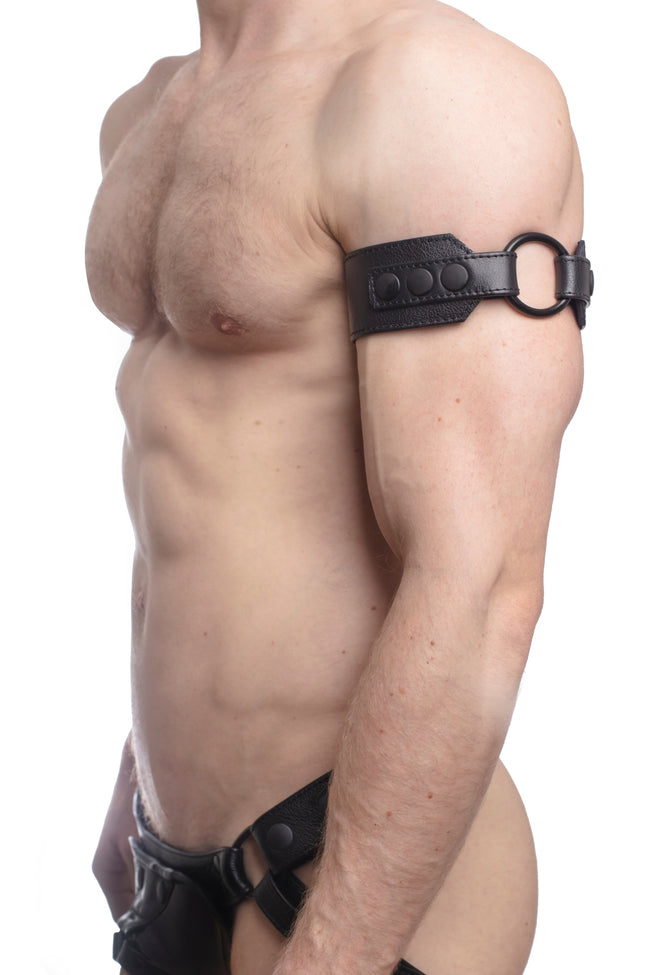 Model wearing a black leather armband with black metal O-ring