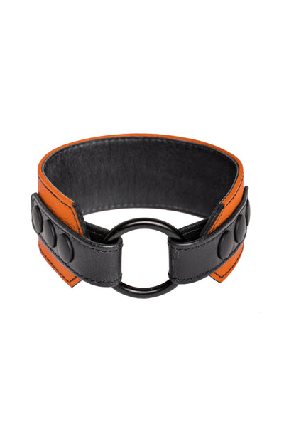 An orange leather armband with black metal O-ring