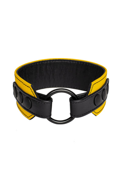 A yellow leather armband with black metal O-ring