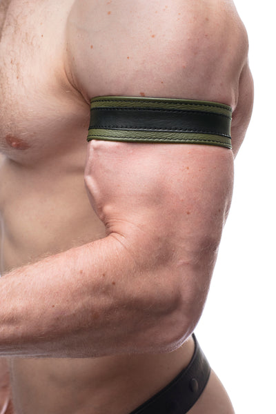 "Model wearing a 1.5"" army green leather armband with black racing stripe detail."