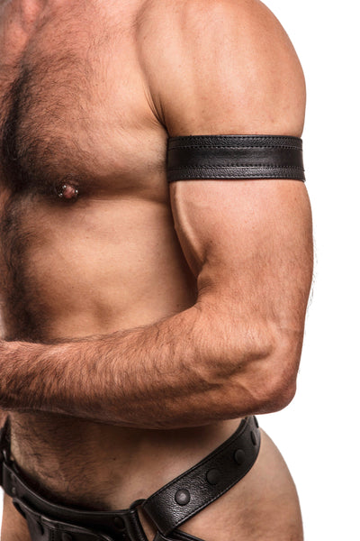 Model wearing black leather racer stripe armband