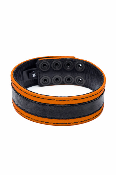 "1.5"" wide orange leather armband with black racer stripe detail"