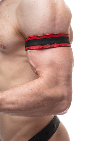 "Model wearing a 1.5"" red leather armband with black racing stripe detail."
