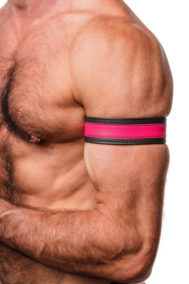 "Model wearing a 1.5"" wide black leather armband with fluro pink leather racer stripe"