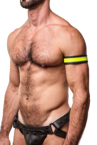 "Model wearing a 1.5"" wide black leather armband with fluro yellow leather racer stripe"