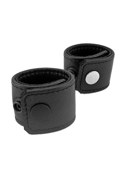 "Black leather and stainless steel 1.5"" wide ball stretchers"