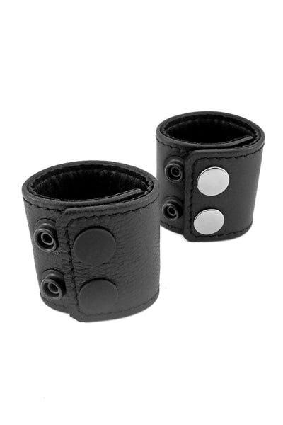 "Black leather and stainless steel 2"" wide ball stretchers"