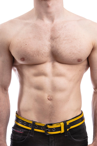 Model wearing yellow leather racer stripe belt