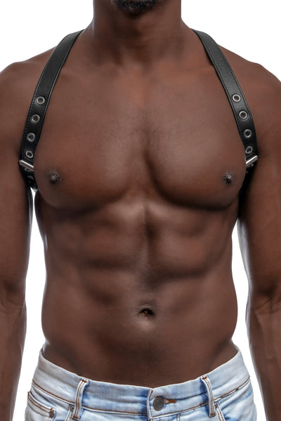 Model wearing black leather braces with stainless steel hardware as shoulder harness. Front 3.