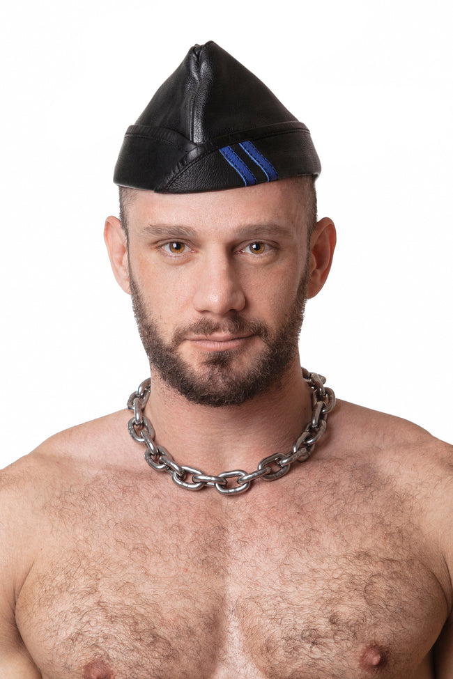 Model wearing black flight cap with blue stripes