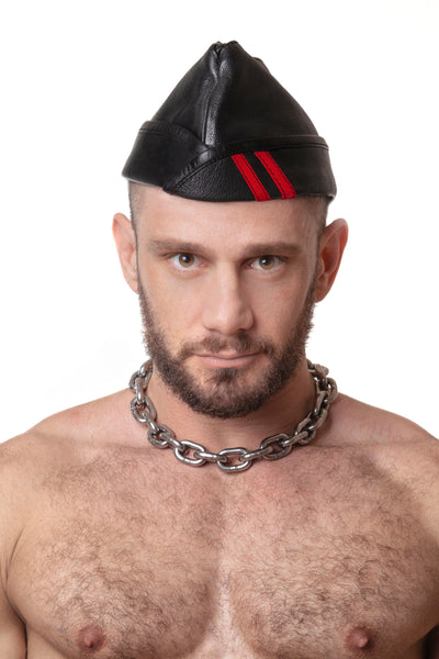 Model wearing black flight cap with red stripes