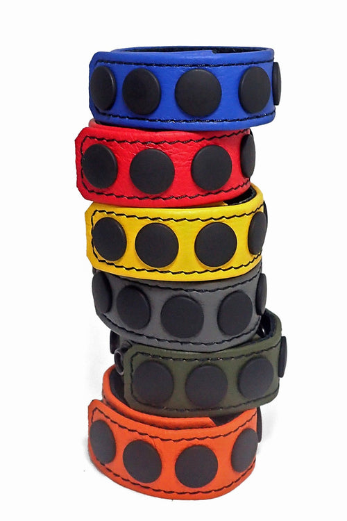 "6 coloured leather 1"" wide cockrings stacked"