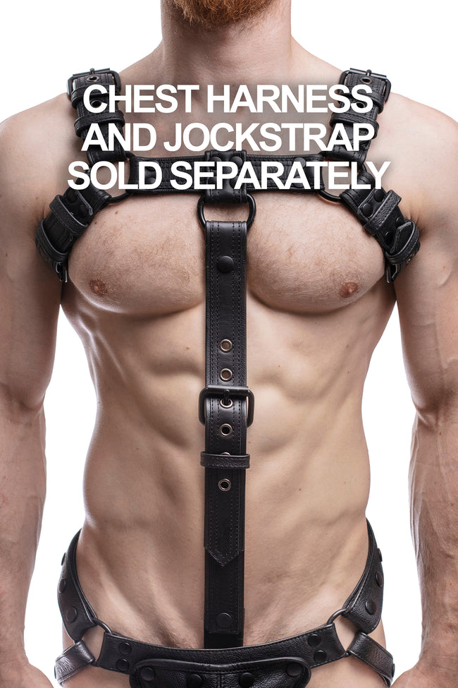 Model wearing black leather bulldog cockstrap with matt black metal hardware