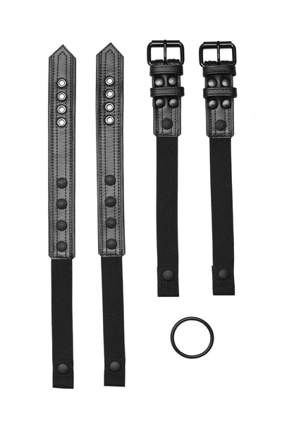 Pair of black leather combat harness connectors with black hardware. Front.