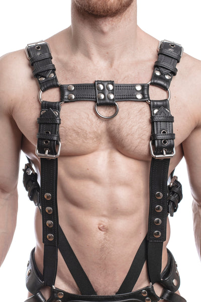 Model wearing a black leather combat harness and connector with stainless steel hardware. Front.