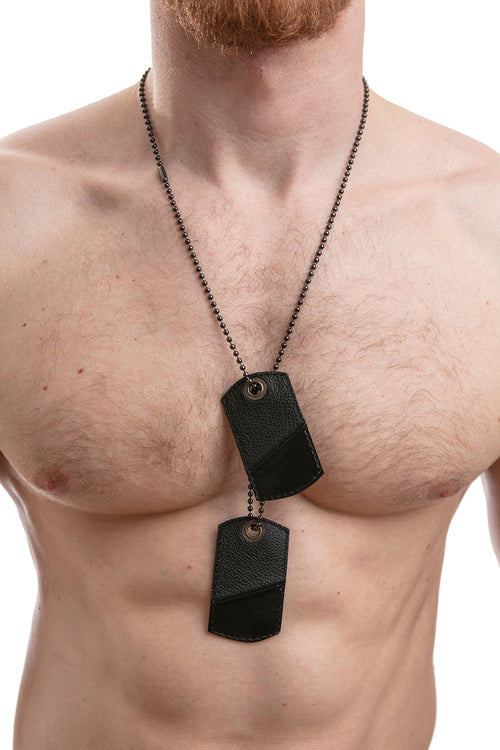 Model wearing black leather dog tags
