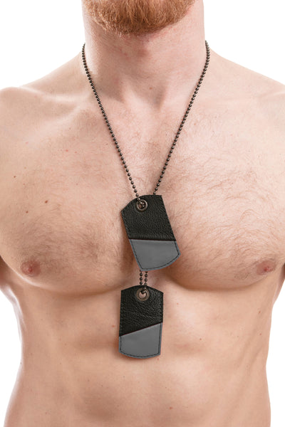 Model wearing grey leather dog tags