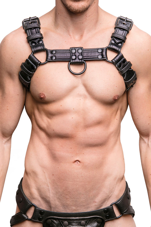 Model wearing black leather combat bulldog harness with matt black metal hardware