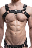 Model wearing a black leather combat harness with stainless steel hardware. Front.