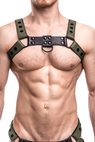 Model wearing an army green leather bulldog harness with black hardware. Front.