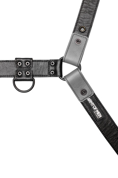 Grey leather bulldog harness with black hardware. Lining.