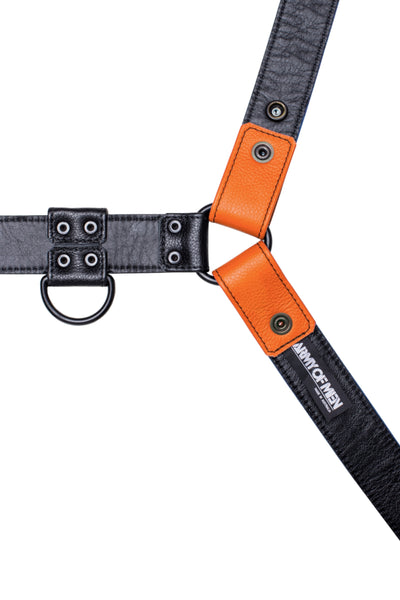 Orange leather bulldog harness with black hardware. Lining.